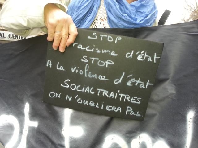 Stop au racisme d'Etat, stop à la violence d'Etat, socialtraîtres on n'oubliera pas [Stop to state racism, stop to state violence, social traitors we won't forget]